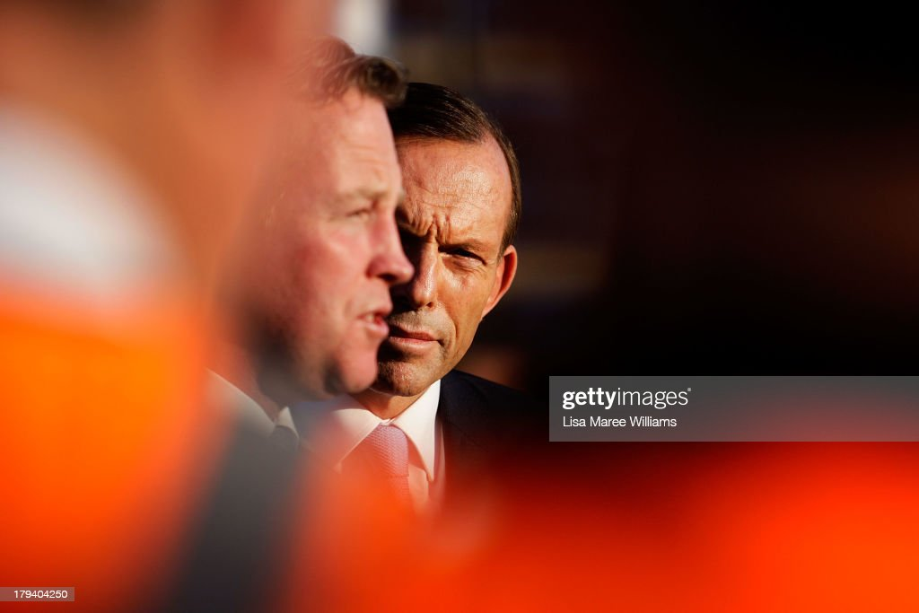 Australian Opposition Leader Tony Abbott and Will Hodgman speak during a press conference at a Austral Brick factory on September 3 2013 in...