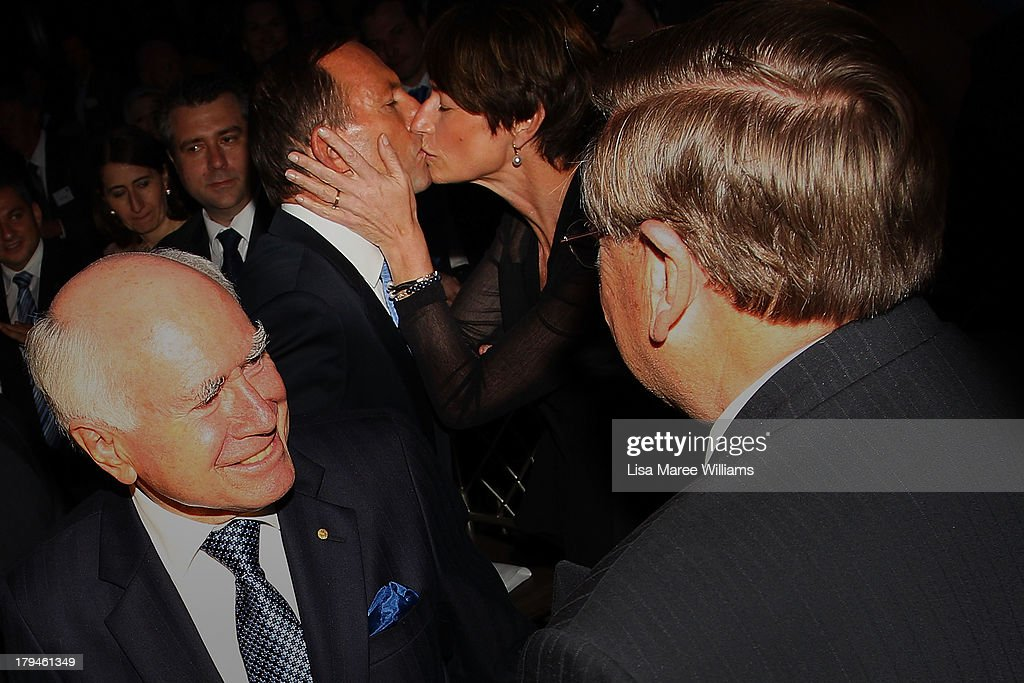 Australian Opposition Leader, <a gi-track='captionPersonalityLinkClicked' href=/galleries/search?phrase=Tony+Abbott&family=editorial&specificpeople=220956 ng-click='$event.stopPropagation()'>Tony Abbott</a> is kissed by his wife Margie Abbott and congratulated by John Howard during a fundraiser dinner in Lilyfield on September 4, 2013 in Sydney, Australia. With just three days of campaigning before Saturday's Federal Election it looks increasingly unlikely that the Australian Labor Party will hold on to government as the Liberal-National Party coalition pulls ahead in polling.