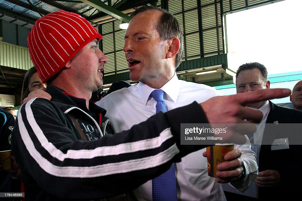 Australian Opposition Leader, <a gi-track='captionPersonalityLinkClicked' href=/galleries/search?phrase=Tony+Abbott&family=editorial&specificpeople=220956 ng-click='$event.stopPropagation()'>Tony Abbott</a> meets voters on the campaign at Sydney Markets on September 4, 2013 in Sydney, Australia. With just three days of campaigning before Saturday's Federal Election it looks increasingly unlikely that the Australian Labor Party will hold on to government as the Liberal-National Party coalition pulls ahead in polling.