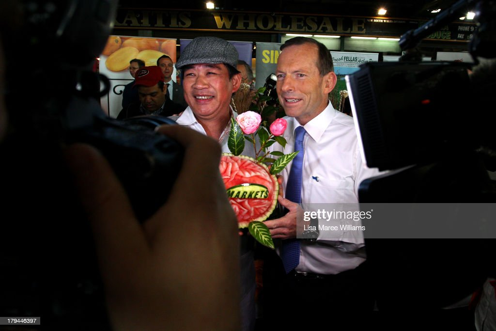Australian Opposition Leader, Tony Abbott meets voters on the campaign at Sydney Markets on September 4, 2013 in Sydney, Australia. With just three days of campaigning before Saturday's Federal Election it looks increasingly unlikely that the Australian Labor Party will hold on to government as the Liberal-National Party coalition pulls ahead in polling.