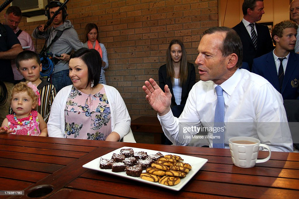 Australian Opposition Leader, <a gi-track='captionPersonalityLinkClicked' href=/galleries/search?phrase=Tony+Abbott&family=editorial&specificpeople=220956 ng-click='$event.stopPropagation()'>Tony Abbott</a> meets with a family to discuss policies on September 3, 2013 in Adelaide, Australia. In the 2010 election the Australian Labor Party recorded its highest two-party-preferred vote since 1969 in South Australia, but if nationwide polling proves accurate the Liberal-National Party coalition believe they can gain seats in the state.