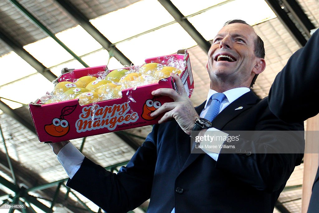Australian Opposition Leader, Tony Abbott participates in a mango auction at Sydney Market on September 4, 2013 in Sydney, Australia. With just three days of campaigning before Saturday's Federal Election it looks increasingly unlikely that the Australian Labor Party will hold on to government as the Liberal-National Party coalition pulls ahead in polling.