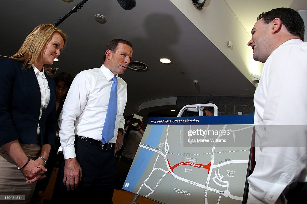 Australian Opposition Leader, Tony Abbott speaks to the media as Liberal candidate Fiona Scott looks on, on September 4, 2013 in Sydney, Australia. With just three days of campaigning before Saturday's Federal Election it looks increasingly unlikely that the Australian Labor Party will hold on to government as the Liberal-National Party coalition pulls ahead in polling.
