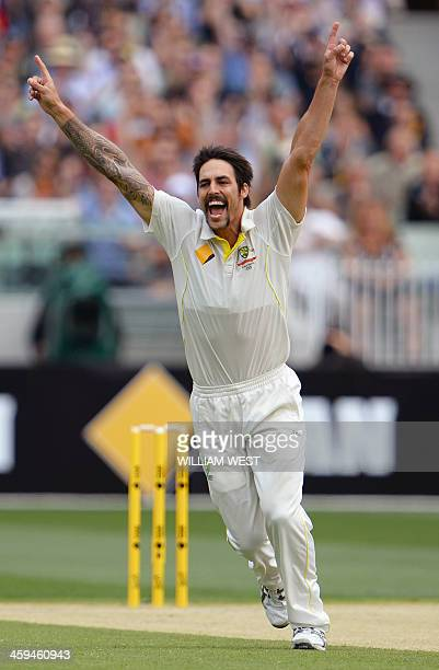 Australian paceman Mitchell Johnson celebrates dismissing England batsman Tim Bresnan on the second day of the fourth Ashes cricket Test played at...