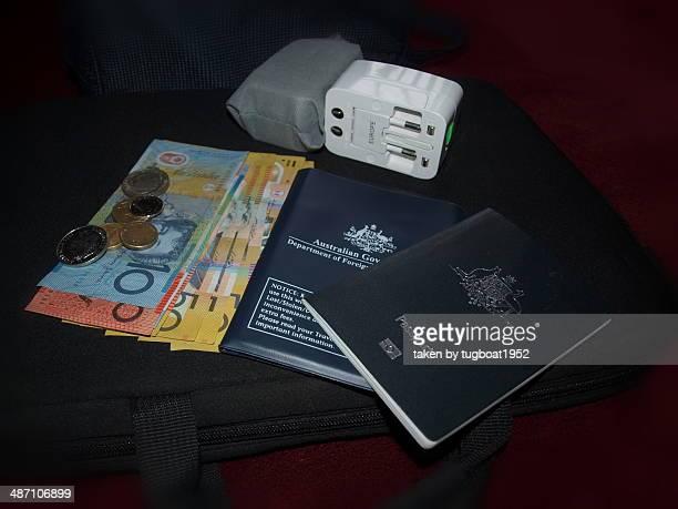 Australian passport, Aussie currenc and power plug