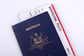 One new Australian passport with an international boarding pass inserted inside the document.