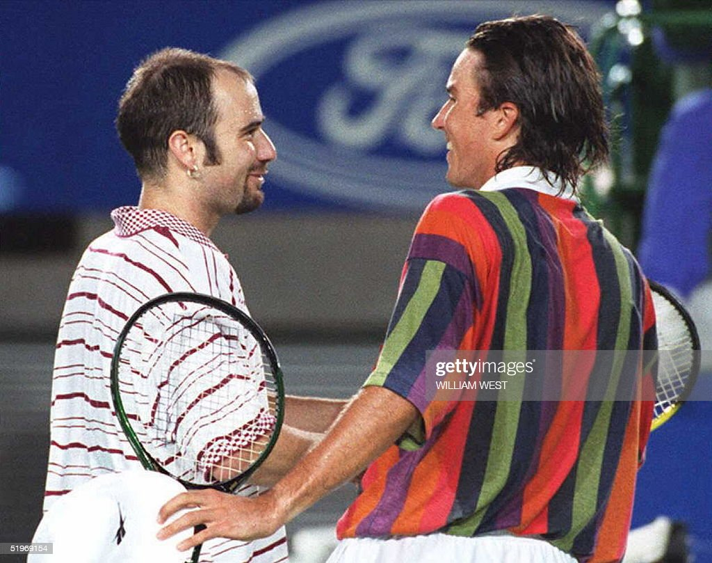 Australian Patrick Rafter R greets Andre Agassi L