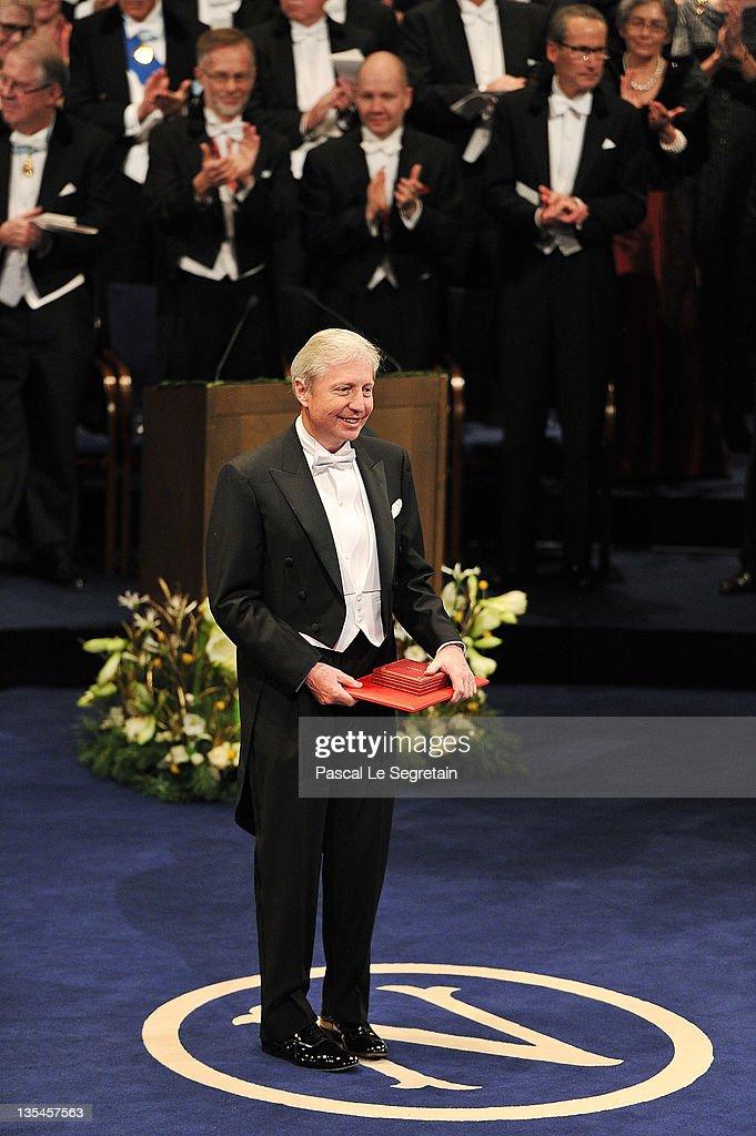Australian physicist Brian Schmidt poses with the Nobel Prize for Physics at the Nobel Prize Award Ceremony at Stockholm Concert Hall on December 10, 2011 in Stockholm, Sweden.