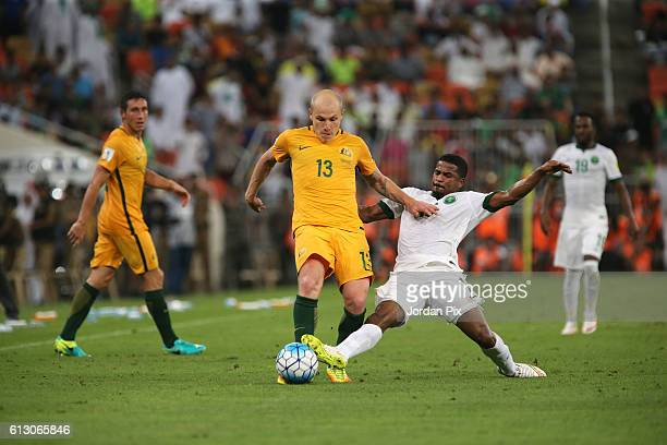 Australian player Aaron Mooy competes with Saudi Nasir Alshamrani during the match between Saudi Arabia and Australia for the FIFA World Cup...