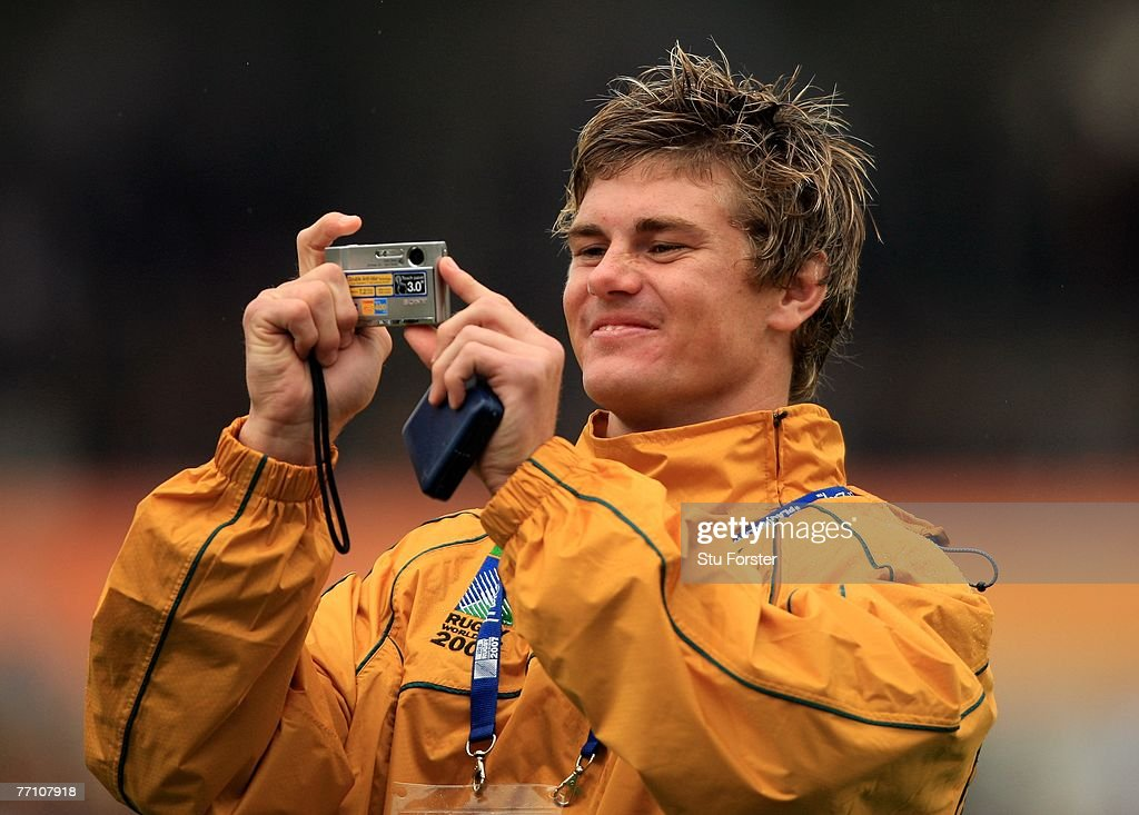 Australian player Berrick Barnes takes a picture after the IRB Rugby World Cup Pool B match between Australia and Canada at the Stade ChabanDelmas on...