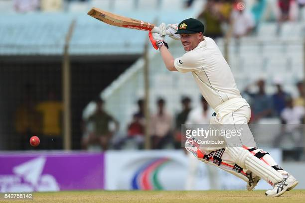 Australian player David Warner plays a shot during the second day of the second cricket Test match between Bangladesh and Australia at Zahur Ahmed...