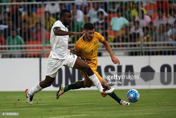 Australian player Mathew Leckie competes with a Saudi player during the match between Saudi Arabia and Australia for the FIFA World Cup Qualifier...