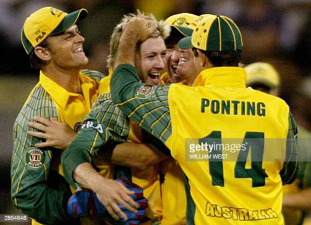 Australian player Michael Clarke is congratulated by his teammates including his captain Ricky Ponting and wicketkeeper Adam Gilchrist after...