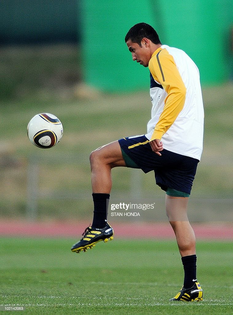 Australian player Tim Cahill kicks a ball during a team training session at Ruimsig Stadium in Roodepoort on June 16, 2010 during the 2010 World Cup football tournament. Cahill will learn on June 17 if he is to receive a one or two-match suspension for his red card against Germany. AFP PHOTO/Stan Honda