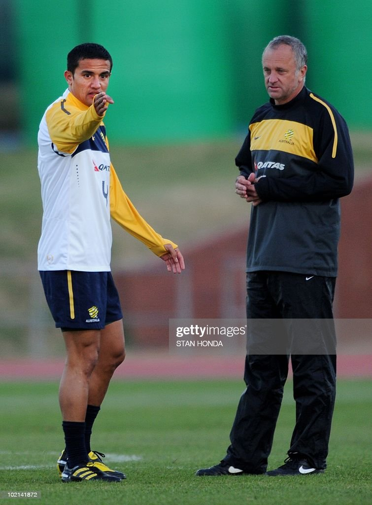 Australian player Tim Cahill (L) talks with assistant coach Graham Arnold (R) during a team training session at Ruimsig Stadium in Roodepoort on June 16, 2010 during the 2010 World Cup football tournament. Cahill will learn on June 17 if he is to receive a one or two-match suspension for his red card against Germany. AFP PHOTO/Stan Honda