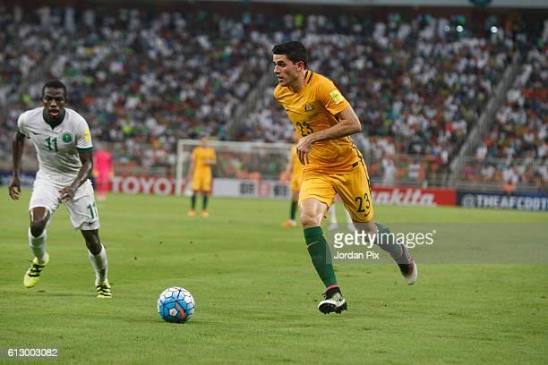 Australian player Tomas Rogic competes with Saudi Abdulamlek Al Khaibri during the match between Saudi Arabia and Australia for the FIFA World Cup...