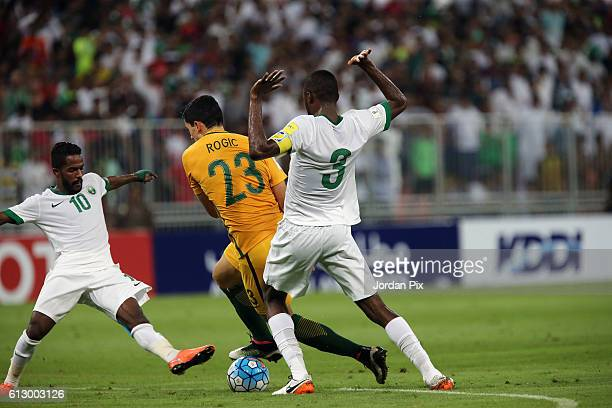 Australian player Tomas Rogic competes with Saudi players during the match between Saudi Arabia and Australia for the FIFA World Cup Qualifier Russia...