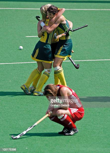 Australian players celebrate after defeating England in the Womens Hockey Semi Final at Major Dhyan Chand National Stadium on day eight of the Delhi...
