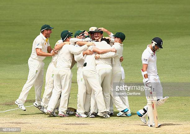 Australian players celebrate after they defeated England during day five of the Third Ashes Test Match between Australia and England at WACA on...