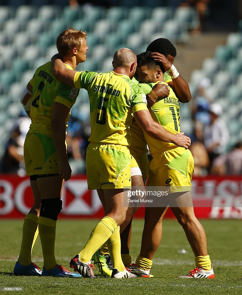 Australian players celebrate after winning the 2016 Sydney Sevens semi-final match between Australia and South Africa at Allianz Stadium on February 7, 2016 in Sydney, Australia.