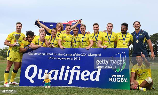 Australian players celebrate after winning the World Sevens Oceania Olympic Qualification Final between Australia and Tonga on November 15 2015 in...