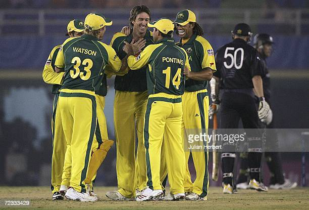 Australian players celebrate Glenn McGraths wicket of Peter Fulton of New Zealand during the semi final of The ICC Champions Trophy between Austalia...