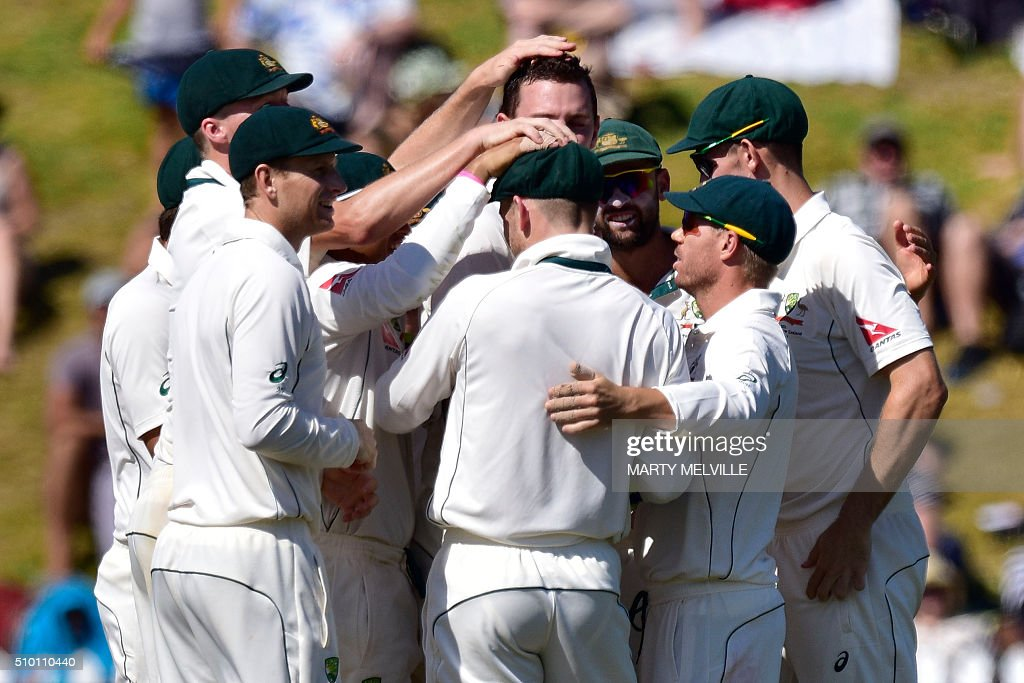 Australian players celebrate New Zealand's Kane Williamson being caught during day three of the first cricket Test match between New Zealand and Australia at the Basin Reserve in Wellington on February 14, 2016. AFP PHOTO / MARTY MELVILLE / AFP / Marty Melville