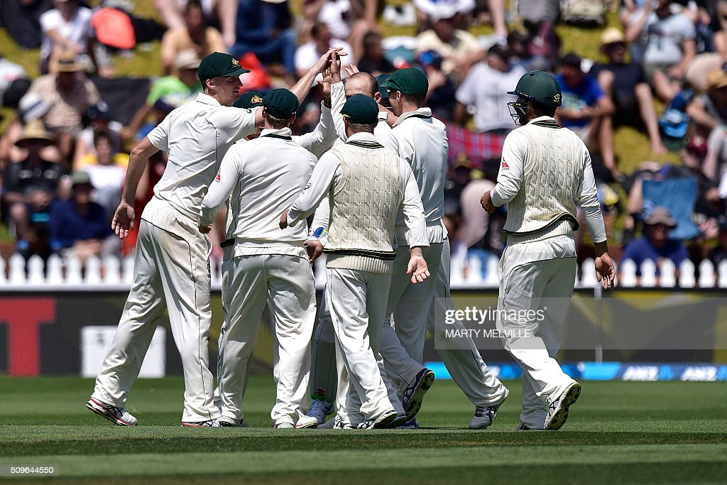 Australian players celebrate New Zealand's Tim Southee being caught during the first cricket international five-day Test match between New Zealand and Australia at the Basin Reserve in Wellington on February 12, 2016. AFP PHOTO / MARTY MELVILLE / AFP / Marty Melville
