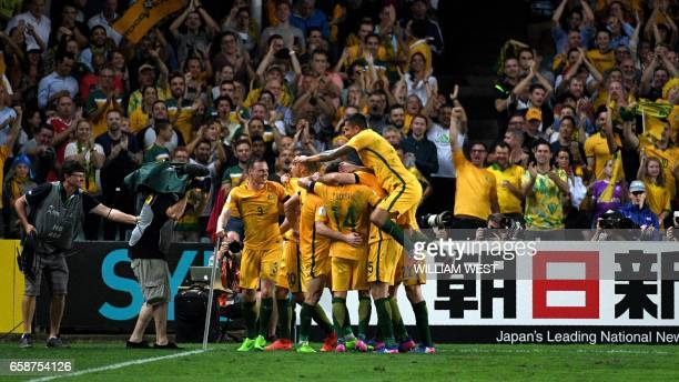 Australian players celebrate scoring against United Arab Emirates in their World Cup qualifying football match in Sydney on March 28 2017 / AFP PHOTO...
