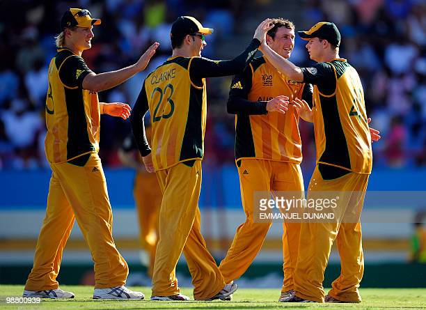 Australian players celebrate the dismissal of Pakistani batsman Mohammad Aamer at the end of the ICC World Twenty20 Group A match between Pakistan...