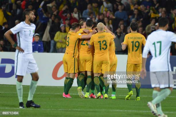 Australian players celebrate their first goal during the World Cup football Asian qualifying match between Australia and Saudi Arabia at the Adelaide...