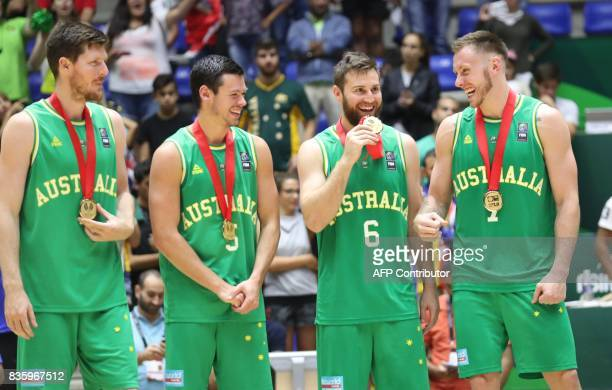 Australian players celebrate their Gold Medal after defeating Iran during their 2017 FIBA Asia Cup final basketball match in the Lebanese town of...