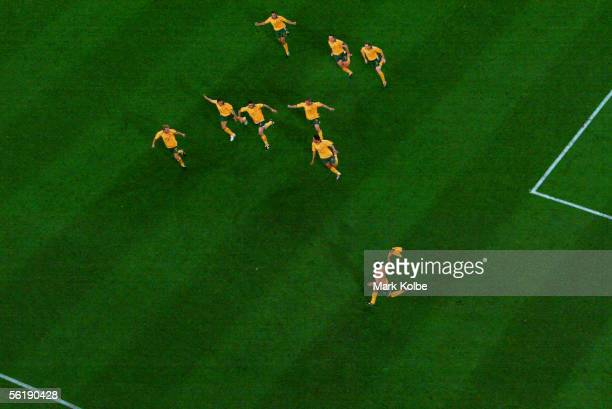 Australian players celebrate victory in the penalty shootout during the second leg of the 2006 FIFA World Cup qualifying match between Australia and...