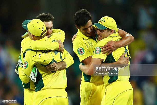 Australian players celebrate winning the 2015 Cricket World Cup Semi Final match between Australia and India at Sydney Cricket Ground on March 26...