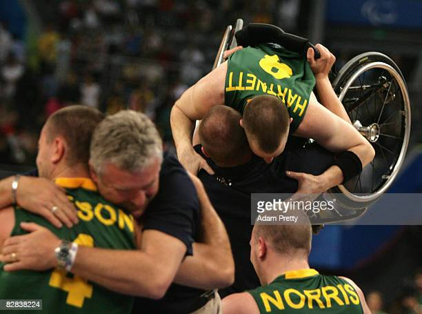Australian players celebrate winning the Gold Medal Wheelchair Basketball match between Australia and Canada at the National Indoor Stadium during...