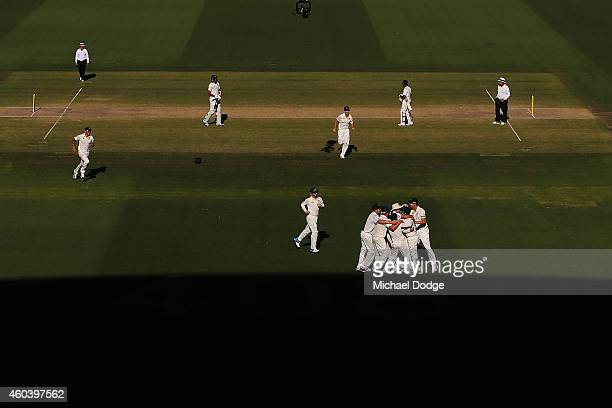 Australian players celebrate winning the match after Ishant Sharma of India was dismissed by Nathan Lyon during day five of the First Test match...