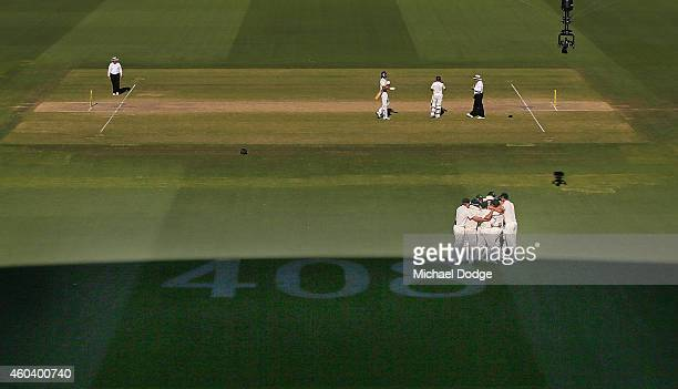 Australian players celebrate winning the match next to the number 408 dedicated to the late Phillip Hughes after Ishant Sharma of India was dismissed...