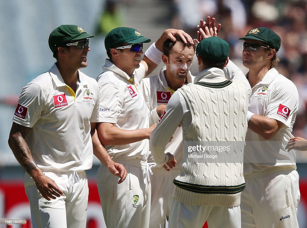 Australian players celebrate with Nathan Lyon (C) who dismissed Chanaka Welegedara of Sri Lanka during day one of the Second Test match between Australia and Sri Lanka at Melbourne Cricket Ground on December 26, 2012 in Melbourne, Australia.