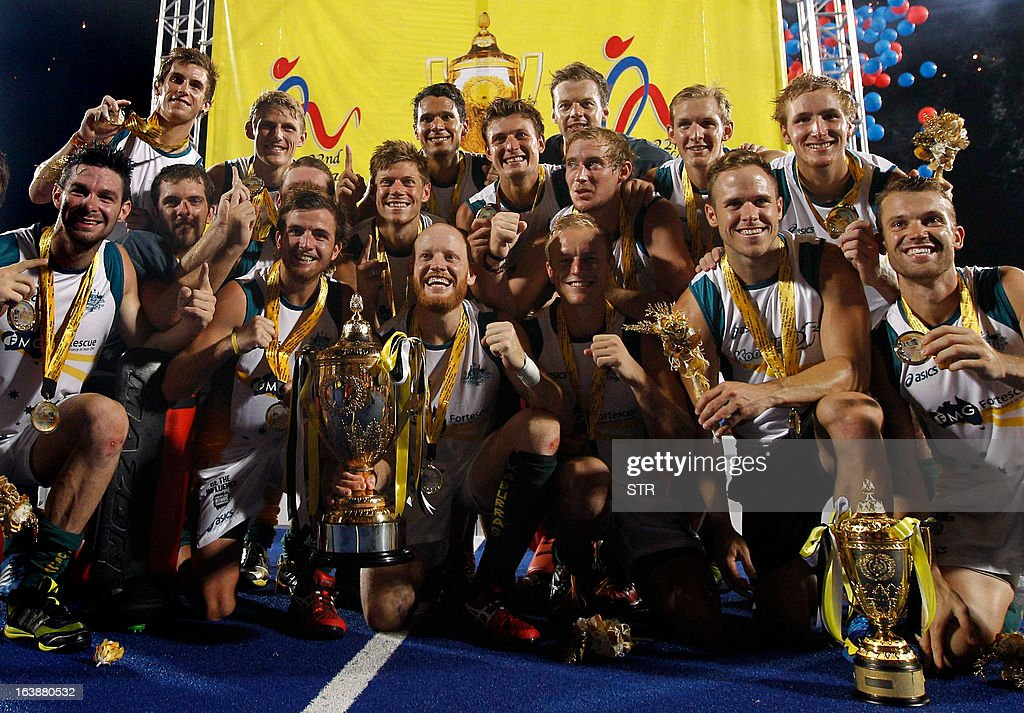 Australian players celebrate with their trophy after defeating Malaysia to win the Sultan Azlan Shah Cup men's field hockey tournament in Ipoh...