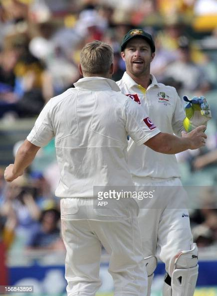 Australian players David Warner and Matthew Wade celebrate the dismissal of South Africa's Hashim Amla during their game on the second day of the...