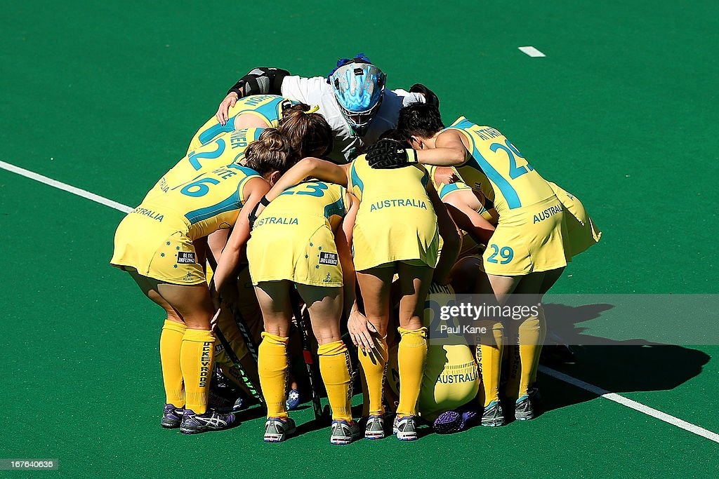 Australian players form a huddle prior to the start of the International Test match between the Australian Hockeyroos and Korea at Perth Hockey Stadium on April 27, 2013 in Perth, Australia.