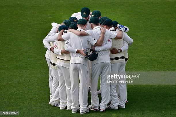 Australian players huddle during day one of the first cricket international fiveday Test match between New Zealand and Australia at Basin Reserve in...