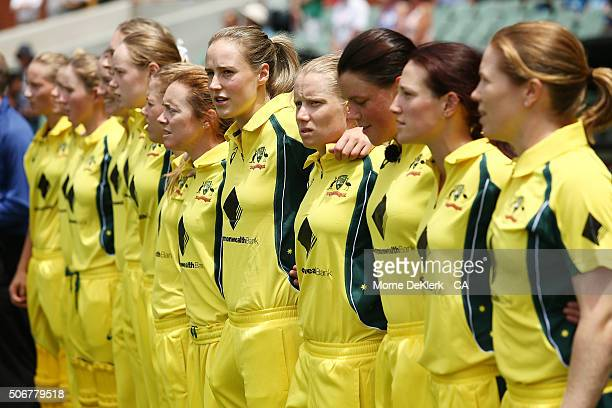 Australian players line up for the anthem ceremony during the women's Twenty20 International match between Australia and India at Adelaide Oval on...