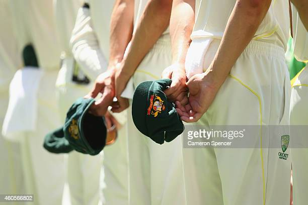 Australian players line up for the Australian national anthem during day one of the 2nd Test match between Australia and India at The Gabba on...