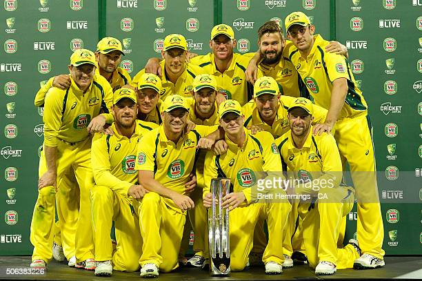 Australian players pose for a photo with the Series Trophy during game five of the Commonwealth Bank One Day Series match between Australia and India...