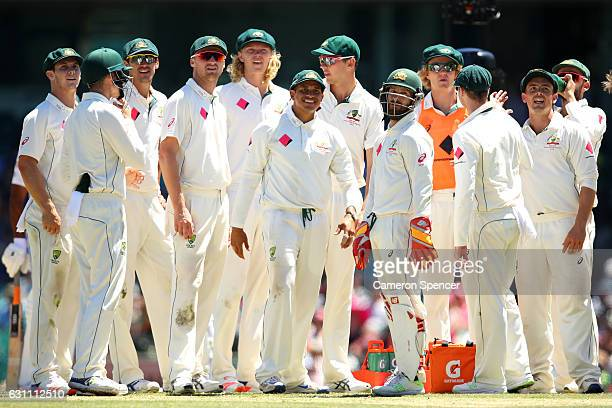Australian players wait for a DRS decision during day five of the Third Test match between Australia and Pakistan at Sydney Cricket Ground on January...