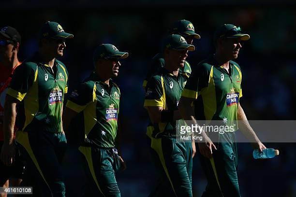 Australian players walk from the field after bowling England out during the One Day International series match between Australia and England at...