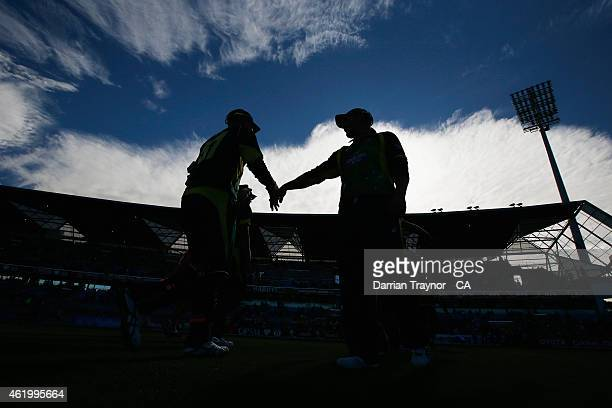 Australian players walk from the field after the first innings during the One Day International Tri Series match between Australia and England at...