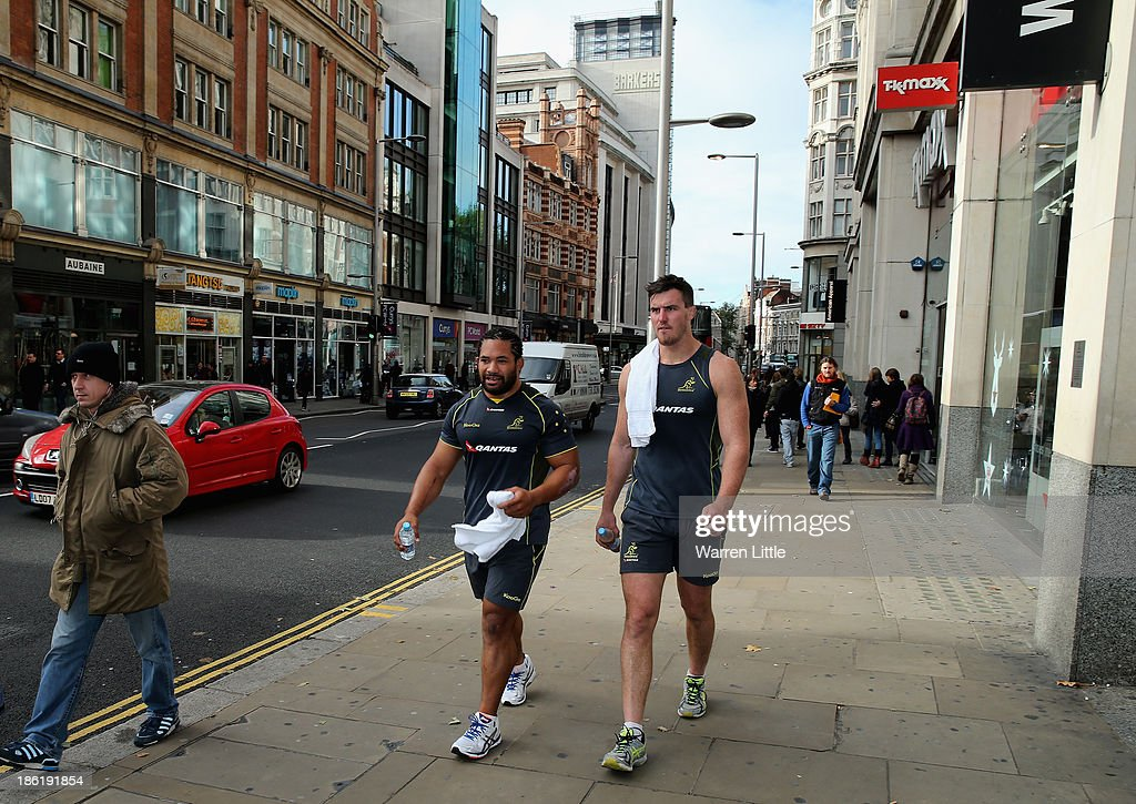 Australian players walk the streets of London near the Royal Garden Hotel on October 29, 2013 in London, England.