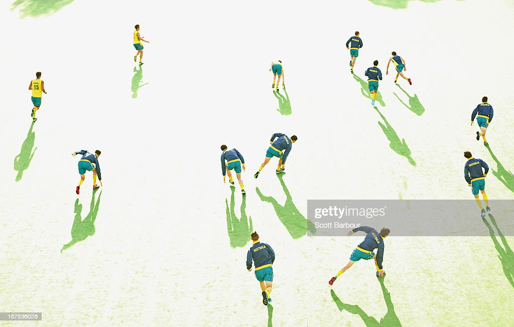 Australian players warm up before the match between the Australia and Pakistan during day three of the Champions Trophy at the State Netball Hockey Centre on December 4, 2012 in Melbourne, Australia.
